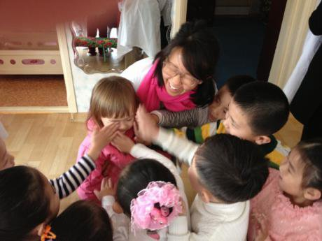 Woman and child surrounded by children