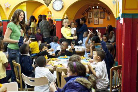 Dinner at a Kids Company drop-in centre, South London