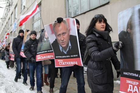 Protesters hold pictures of dead or imprisoned opposition activists as they walk through the streets of Minsk, March 2013