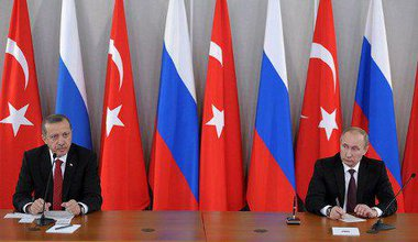Erdogan meets Putin against backdrop of Turkish and Russian flags in St Petersburg.