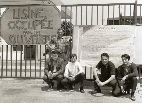 French_workers_with_placard_during_occupation_of_their_factory_1968_0.jpg