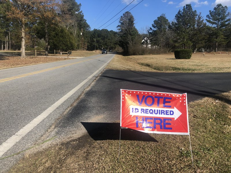 Barriers to voting: A sign outside a rural polling station in Georgia