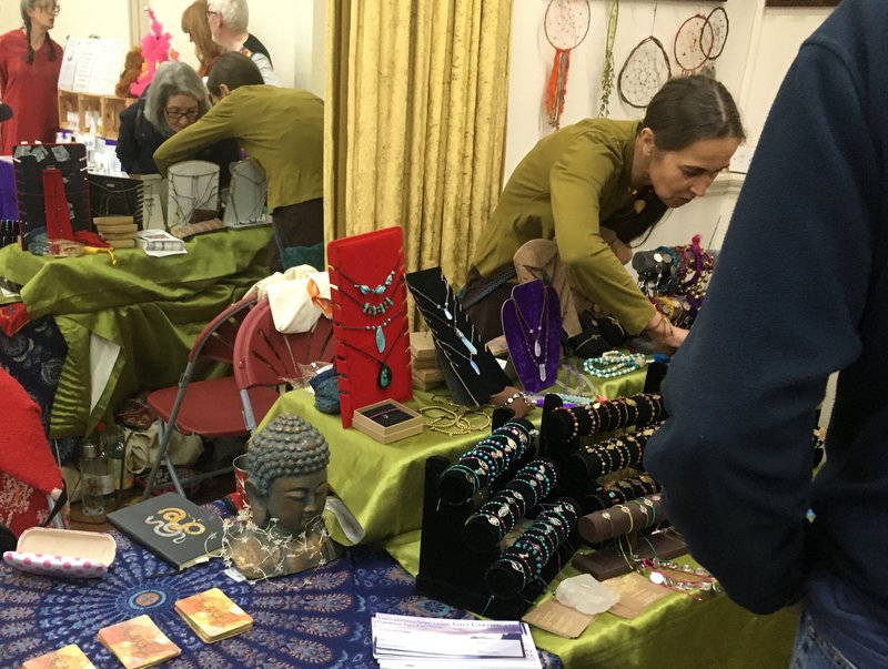 A stall selling jewelry and tarot card readings at a Vegan festival in Saltburn. Image: Adam Bychawski.