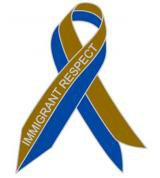Blue and red awareness ribbon with 'Immigrant respect' written on it