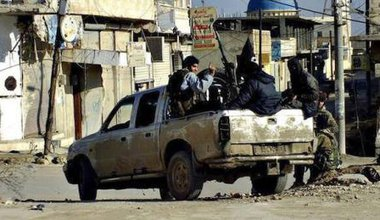 IS fighters in Raqqa with captured weapons, Jan 2014.