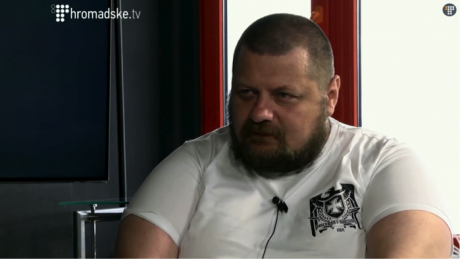 Ihor Mosychuk in the studio of Hromadske TV, wearing a t-shirt produced by the neo-Nazi brand Doberman Aggressive.