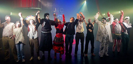 Juliano Mer Khamis (centre) takes a bow with the cast of Alice in Wonderland at The Freedom Theatre, Jenin