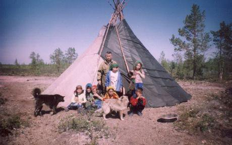 A Khanty family in front of a chum in 2006.
