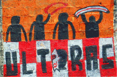 Silhouette figures over a red and white checked area with 'Ultras' written on it.