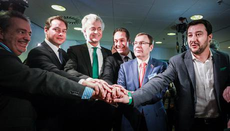 Leaders of European Eurosceptic groups talk at the the Federal Congress of Lega Nord, unity symbolized by one hand atop another