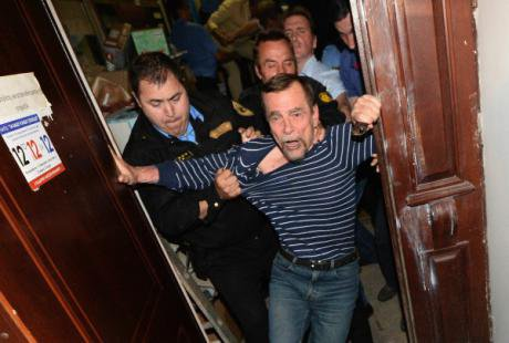 Lev Ponomaryov escorted from 'For Human Rights' after the Moscow government refuses to renew the organisation's lease.