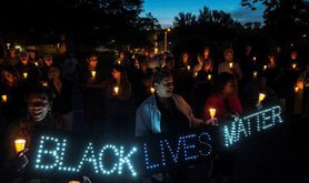 Candlelight vigil for the victims of the Charleston church shooting. Light Brigading/Flickr. Some rights reserved.