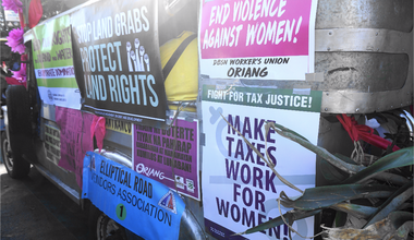 Make taxes work for women sign.png