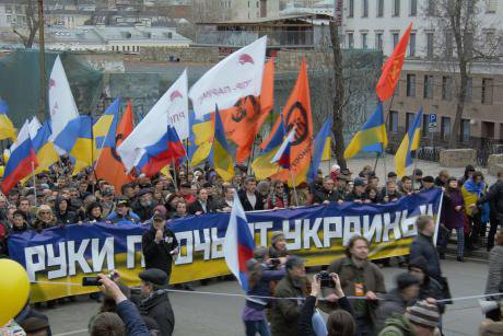 'March for Peace' on 15 March 2014 in Moscow. Banner reads 'Hands off Ukraine.'
