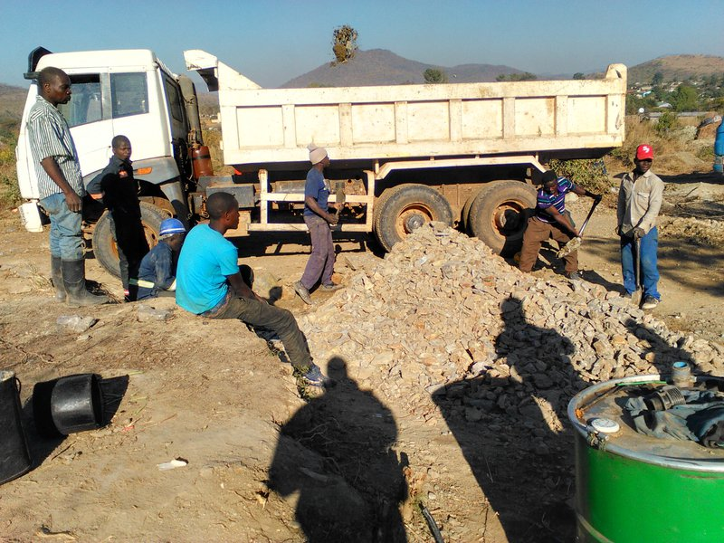 Men and boys load ore into truck.jpg