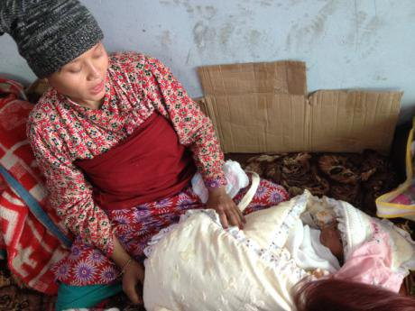 Woman with baby wrapped in blankets