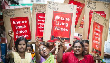 ActionAid-trained women garment workers in Savar, marching to demand their rights under Bangladesh labour laws.