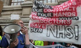 Not_Safe_-_Not_fair_protest_by_doctors,_junior_doctors_and_medical_students_in_central_London_28th_September_2015___8._c._Steve_Eason_0.jpg