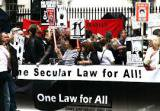 Demonstrators hold 'One law for all' banner