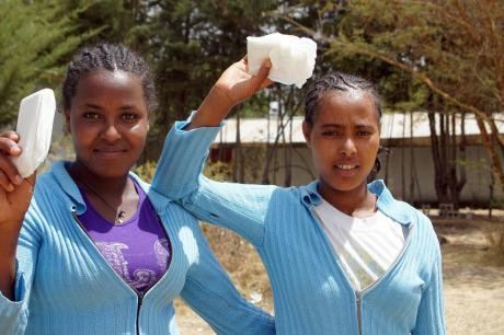 Students holding sanitary pads.