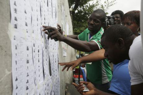 Nigerian citizens look for their names before they register to vote in Lagos. (Credit: Sunday Alamba for AP/PA)