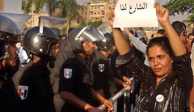"""An Egyptian activist holds a poster which reads, """"the street is ours"""". Amr Nabil/Press Association Images. All rights reserved."""