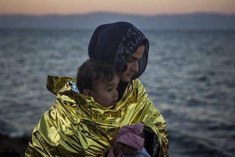 Woman and child, Lesbos, 2015. Santi Palacios/AP/Press Association Images. All rights reserved.
