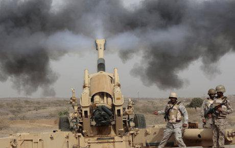 Saudi soldiers fire artillery toward three armed vehicles approaching the Saudi border with Yemen