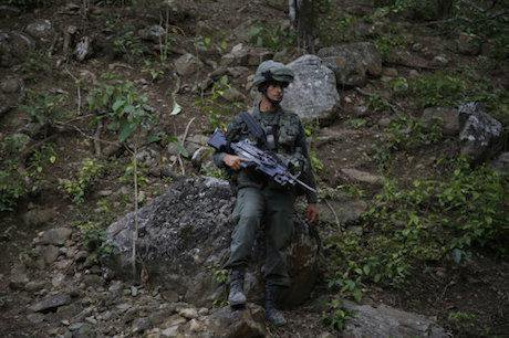 Counter-narcotics officer, Colombia. Fernando Vergara/AP/Press Association Images. All rights reserved.
