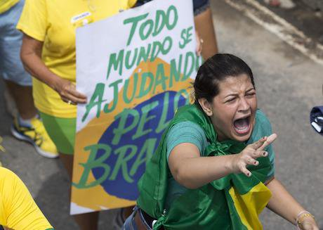 A demonstrator shouts slogans during a protest in Brazil in March. Credit: Silvia Izquierdo/AP/