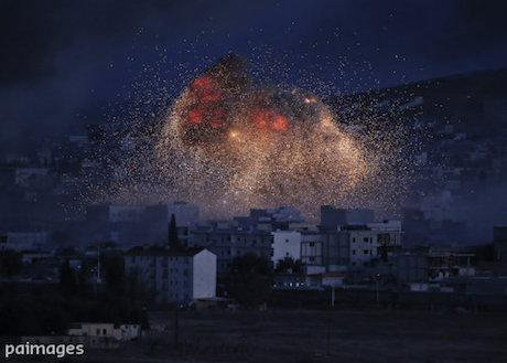 airstrike by the U.S.-led coalition in Kobani, Syria, 2014. Lefteris Pitarakis/AP/Press Association Images. All rights reserved.