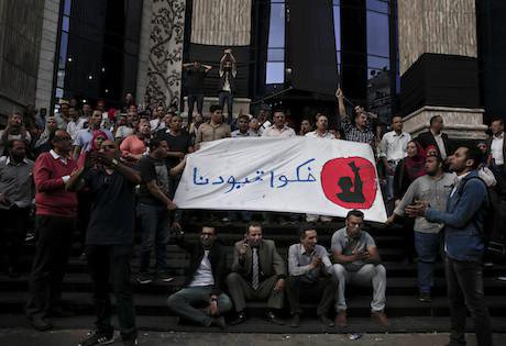 """Arabic on the banner reads, """"remove our shackles."""" Cairo. 3 May 2016."""
