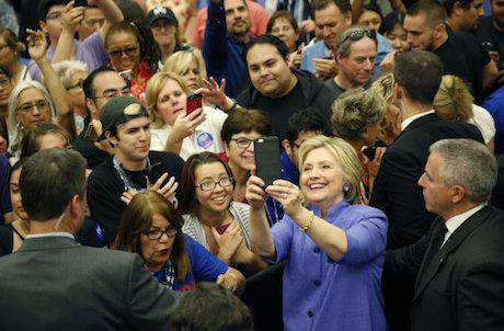 Hillary Clinton stops for a selfie. John Locher / AP/Press Association Images. All rights reserved.