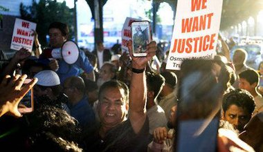 Demonstration for justice after shootings of Akonjee and Udin, 2016. AP Photo/PA Images/Craig Ruttle. All rights reserved.
