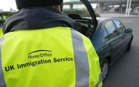A UK Immigration officer checks cars crossing over from France. Gareth Fuller / PA Wire/Press Association Images