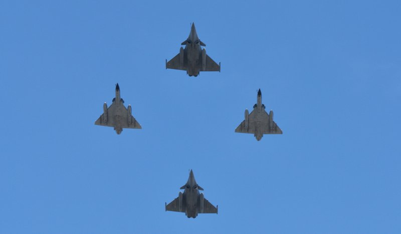 Military aircraft flying overhead