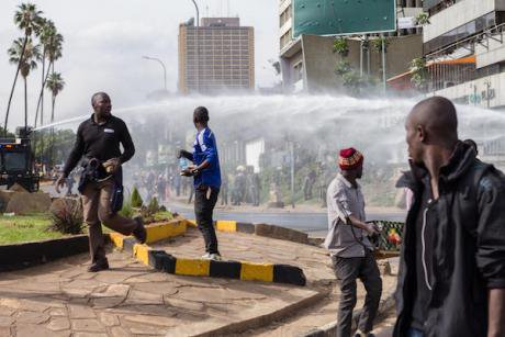 Nairobi police use water cannon on a crowd during post-election unrest in 2017