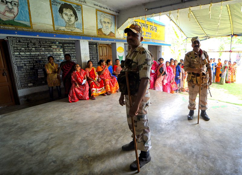 A Central Industrial Security Force officer stands on guard at a polling station during the final phase of General Elections in Baruipur, West Bengal, May 2019.