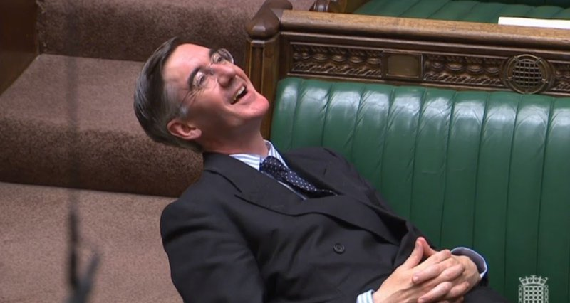 Jacob Rees-Mogg reclines on the parliamentary benches
