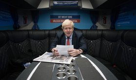 Boris Johnson, works in his campaign bus as he heads to the Kent Event Centre, Maidstone, 6 December 2019