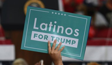 A supporter of US President Donald Trump holds a placard saying 'Latinos for Trump' during a rally.