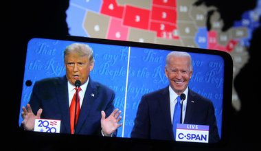 Split-screen image of Donald Trump and Joe Biden in the final presidential debate, October 2020, with a map of blue and red US states in the background