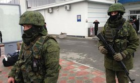 Soldiers without insignia politely patrol Simferopol airport on 28 February.