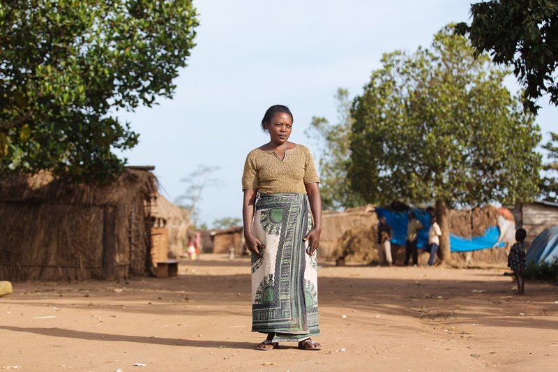 Perpetua_Standing_in_Kijayo_Displacement_Camp,_She_was_evicted_from_her_land_to_pave_way_for_sugarcane_plantation_-_Photo_credit_-_NAPE.jpg