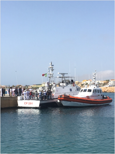 Survivors and officials board boats in preparation for the 3 October memorial at sea (Author provided)