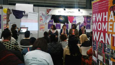 Presenting the UNWomen treatment access review in the Women's Networking Zone, Global Village.jpeg
