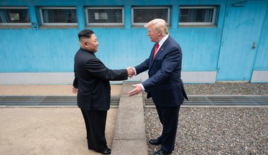 President Donald J. Trump shakes hands with Chairman of the Workers' Party of Korea Kim Jong Un Sunday, June 30, 2019, as the two leaders meet at the Korean Demilitarized Zone, 30 June 2019