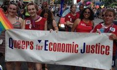 Group of people hold a 'Queers for Economic Justice' banner
