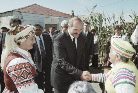 Belarusian President Alyaksandr Lukashenka meets with villagers in traditional clothing.