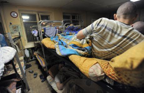 Addicts on tightly backed bunk beds in City Without Drugs dormatory